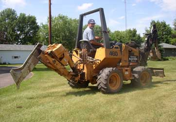 Cable plow to bury underground wire by Gray Electric of Mauston and Tomah, WI