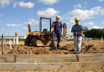 Burying electric pipes by Gray Electric of Mauston and Tomah, WI
