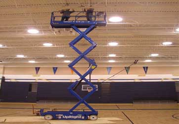 Scissors lift repairing light fixtures by Gray Electric of Mauston and Tomah, WI