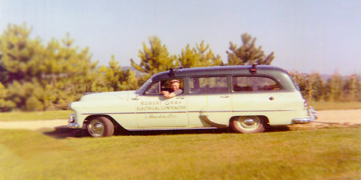 Bob Gray in first company car of Gray Electric in Mauston, WI